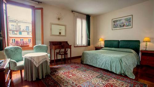 Locanda San Barnaba hotel's guest room in Venice, Italy.