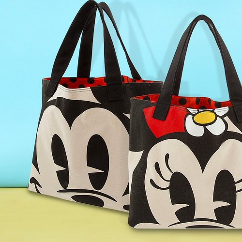 The Disney Store's Mickey and Minnie Mouse tote bags, available in Venice, Italy.