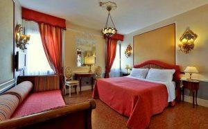 Hotel Arlecchino Venezia guest room in Venice, Italy.